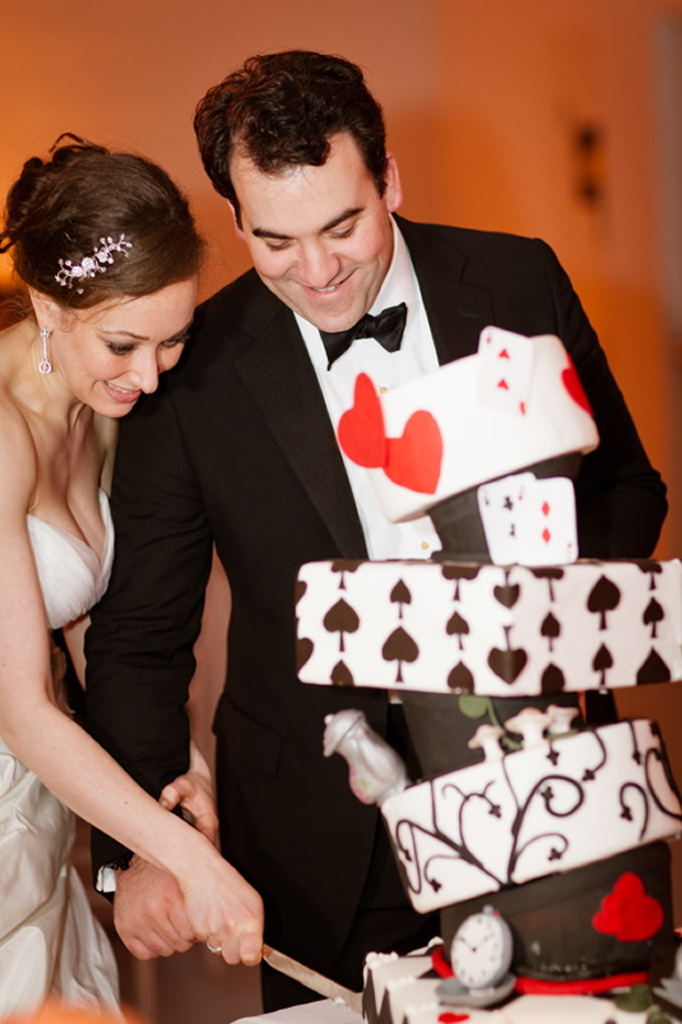 "When another groom proposed in front of NYC's Alice in Wonderland statue, they created a ""toppling"" fantasy cake."